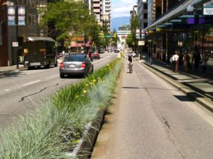 Biking in Vancouver, separated from cars by a physical median. (Flickr, via Jeff Arsenault)